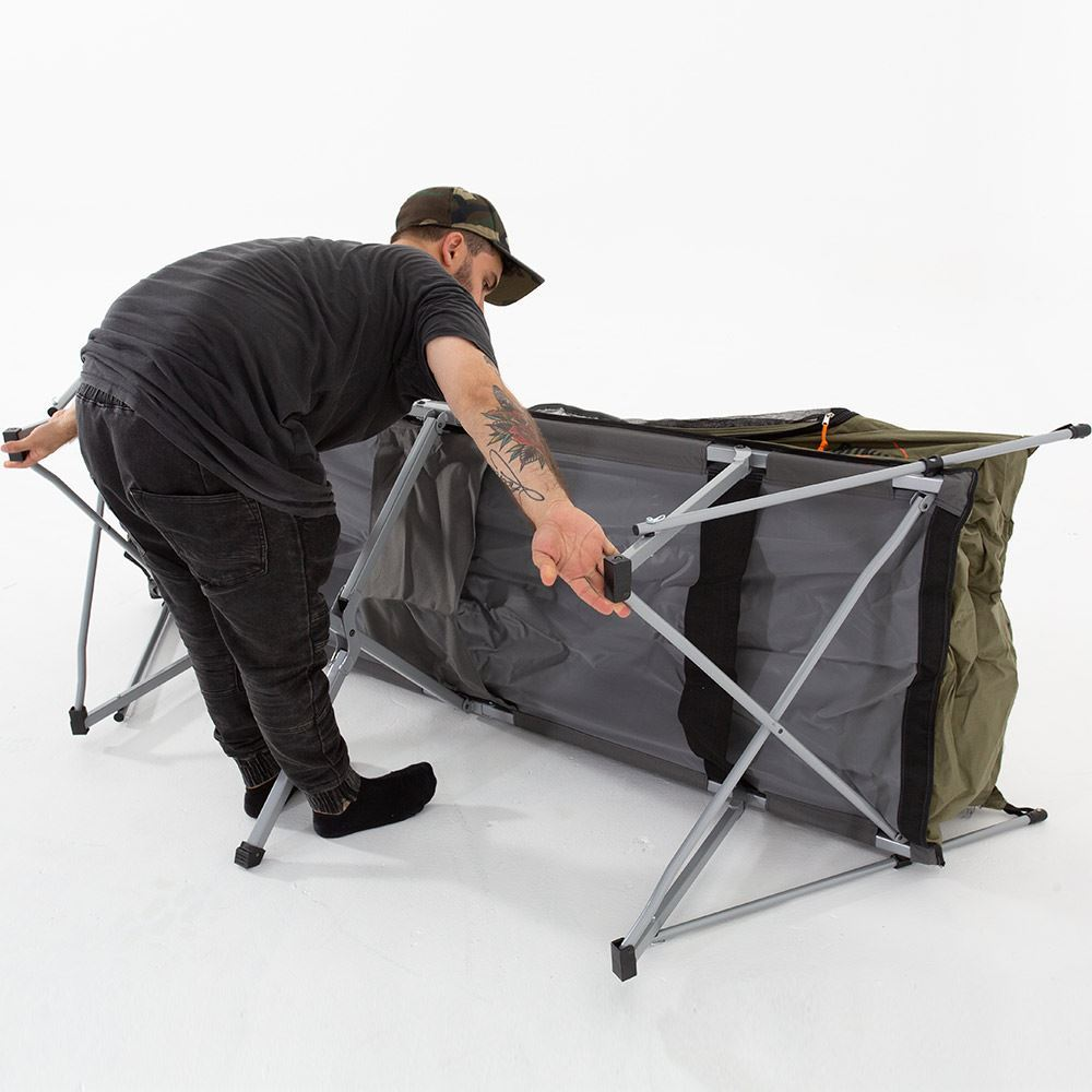 Oztent Bunker Stretcher - Man setting up (stage 7)