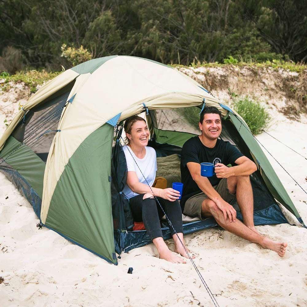 Oztrail Skygazer 4XV Dome Tent - Couple sitting inside drinking from a mug