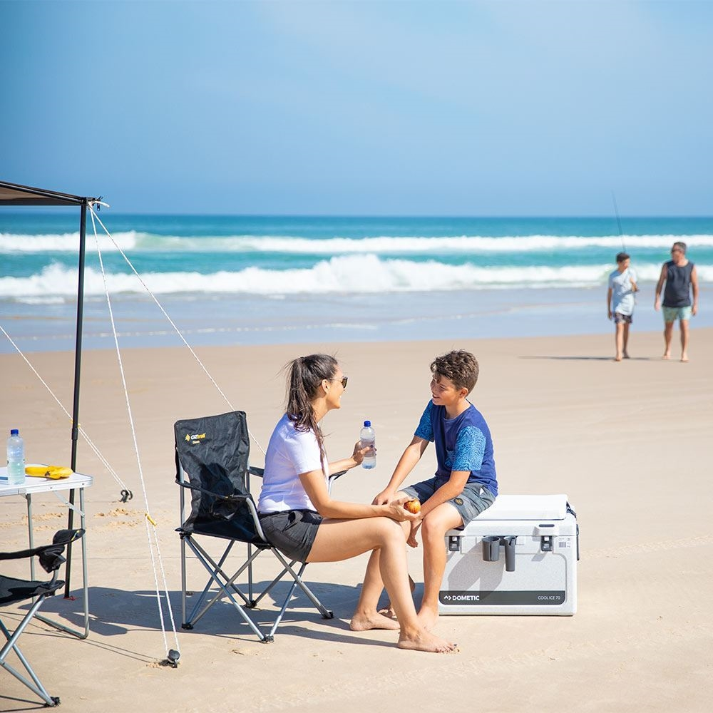 Dometic Cool Ice CI 70 Icebox - Boy sitting on icebox at beach