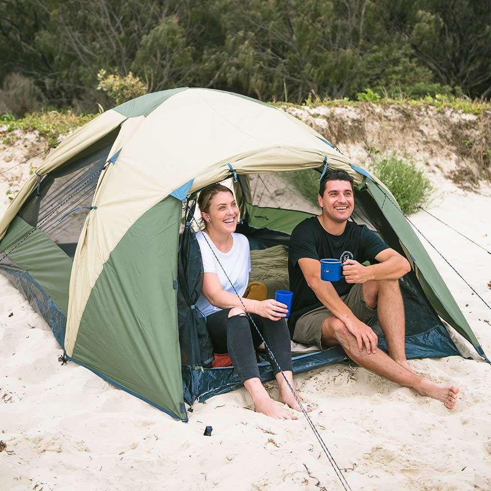 Oztrail Skygazer 3XV Dome Tent - Couple sitting on edge of tent