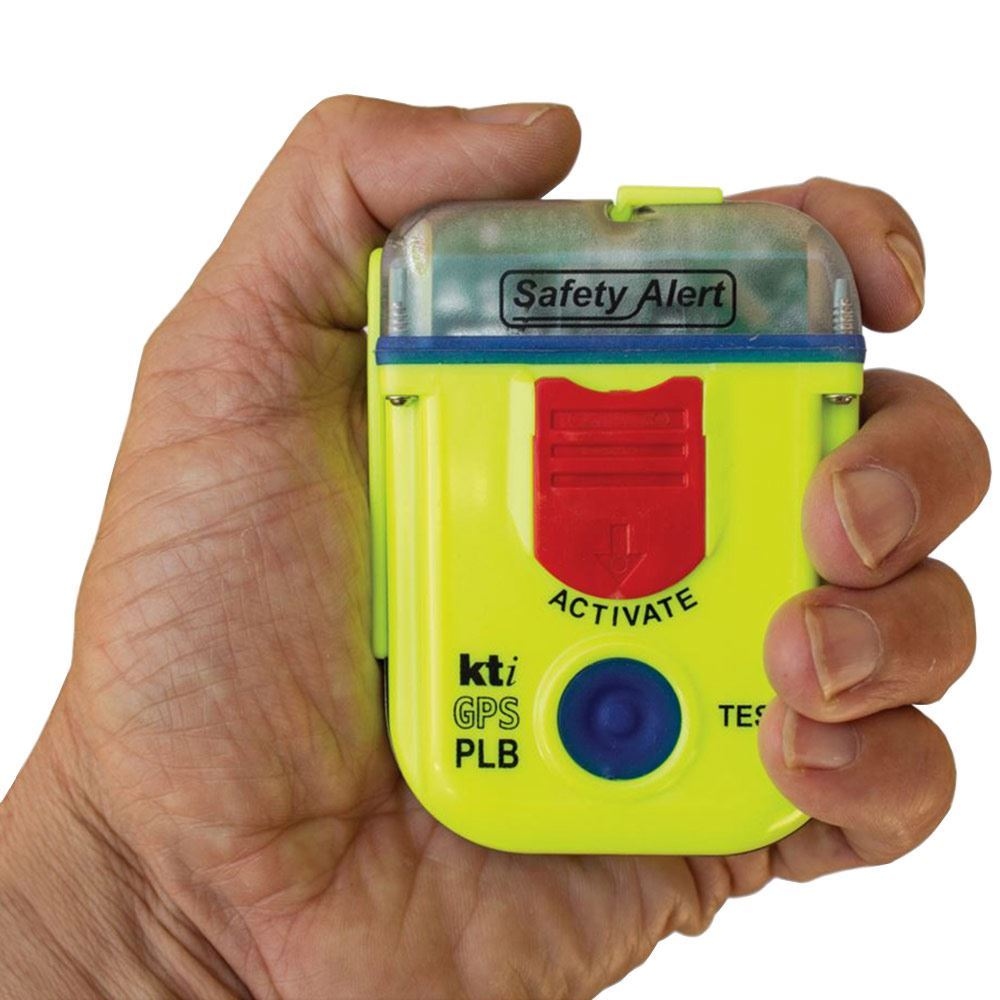 KTI Safety Alert Personal Locator Beacon - Man holding PLB in hand