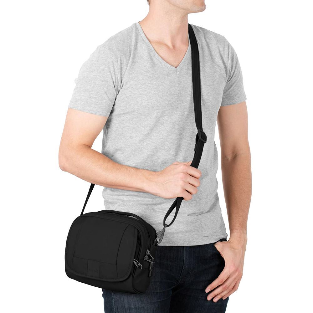 Pacsafe Metrosafe LS140 Shoulder Bag - Man wearing bag