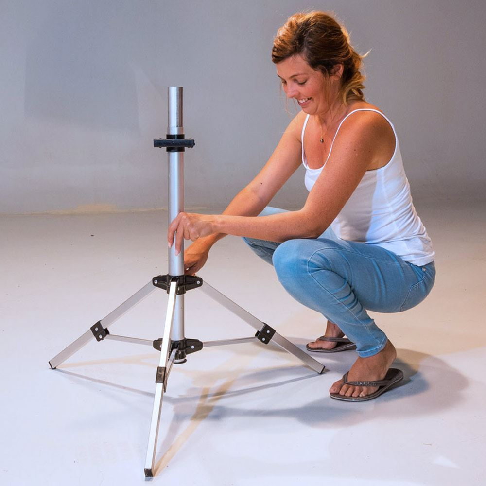 Smarttek Tripod Stand - Woman setting up
