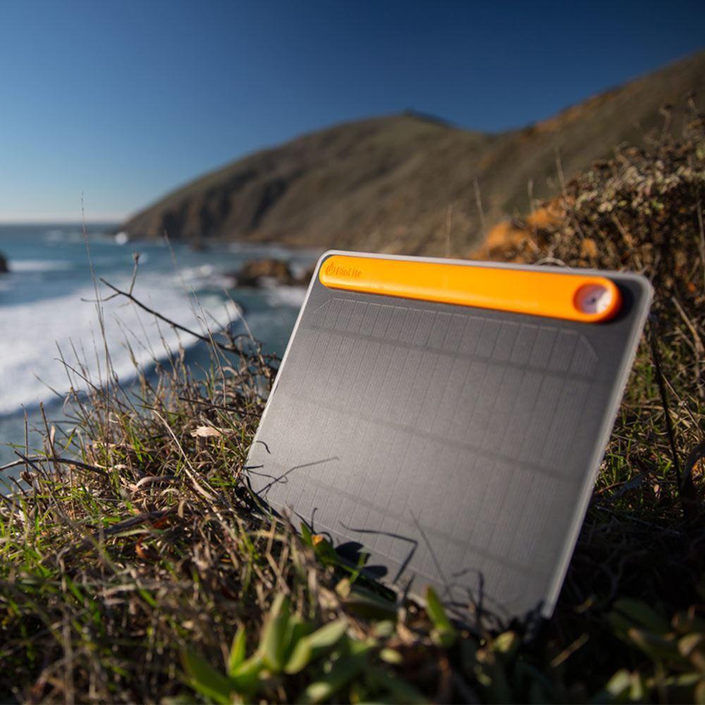 BioLite Solar Panel 5+ - Resting on ocean cliff