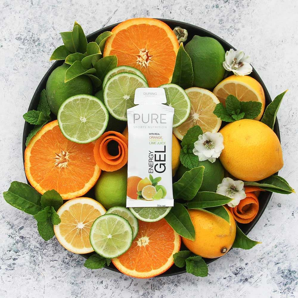 Pure Sports Nutrition Pure Energy Gel Orange Lemon Lime - Resting on lemons, limes & oranges in a bowl