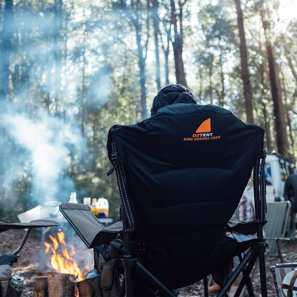 Oztent King Goanna Camp Chair - Woman sitting in chair by campfire