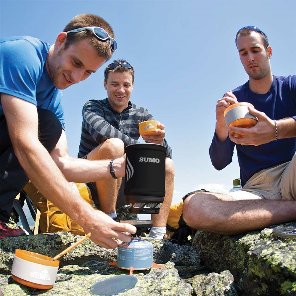 JetBoil Sumo Hiking Stove - Men eating cooked food from the JetBoil Sumo Hiking Stove