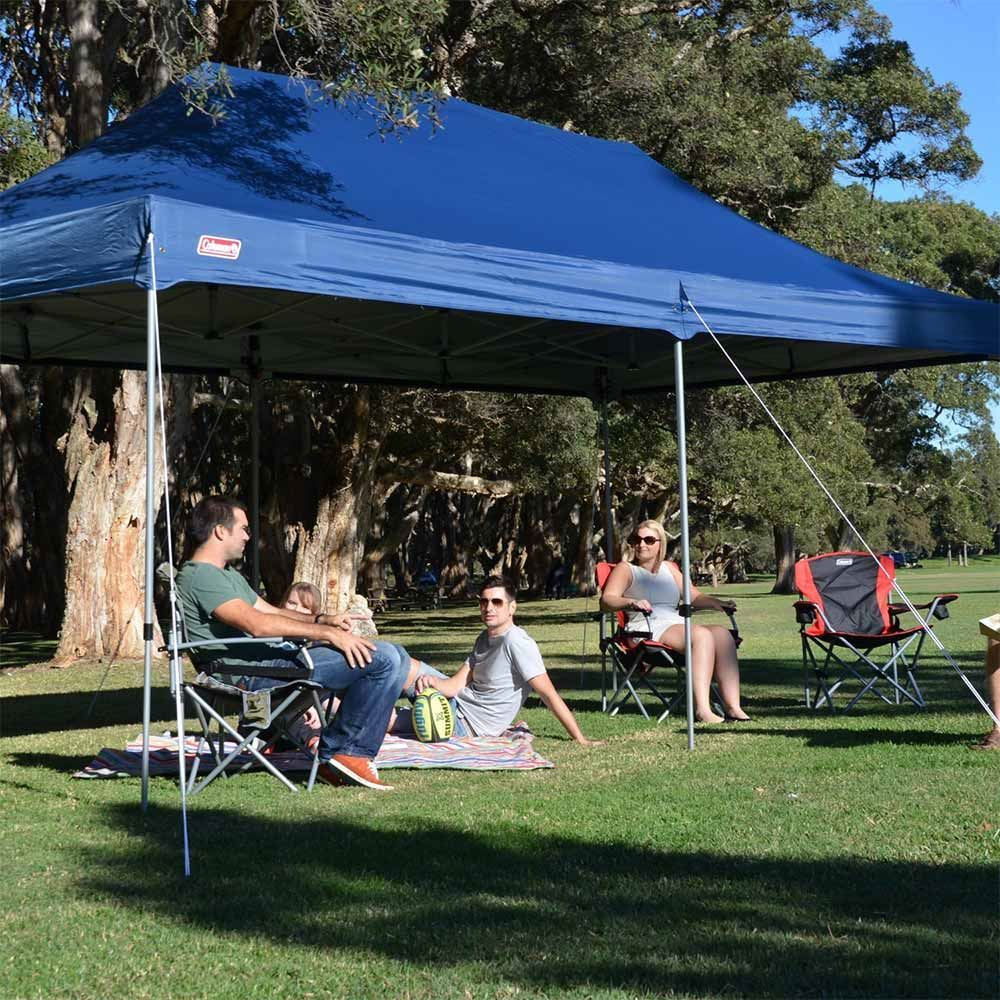 Coleman Deluxe Gazebo 6 x 3 - People sitting underneath gazebo outdoors