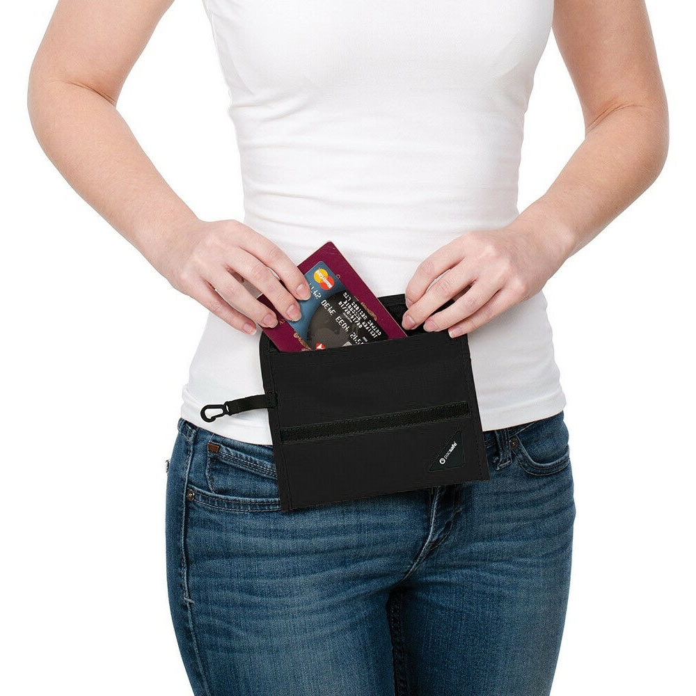 Pacsafe Coversafe V50 RFID Passport Protector - Woman pulling passport and bank cards out of wallet