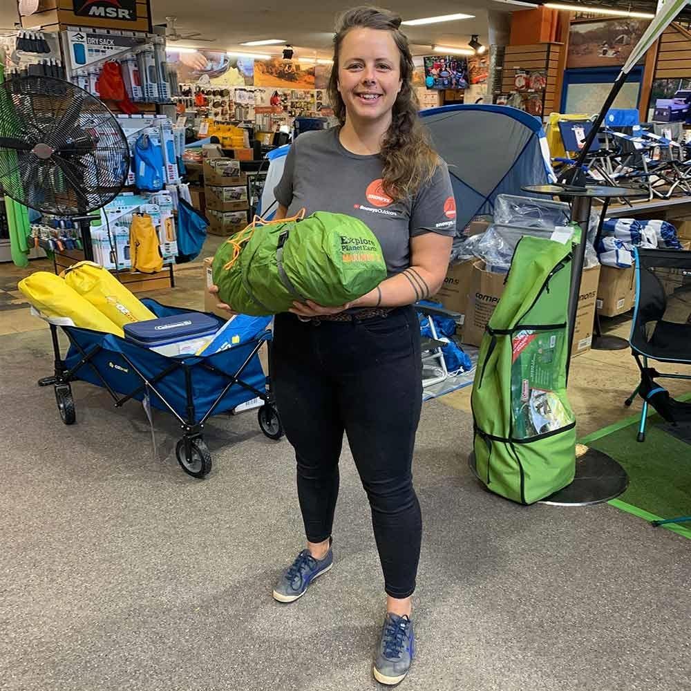 Explore Planet Earth Maximus 3 Hiking Tent - Snowys team member holding tent bag