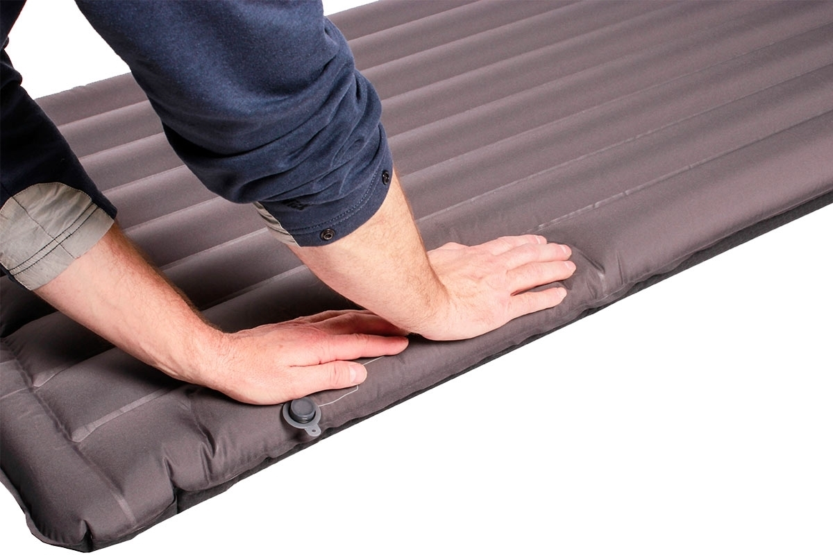 Exped Synmat 7LW Sleeping Mat - Person filling mat up with air by pumping it