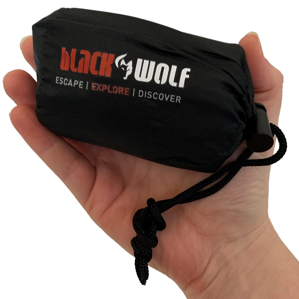 Black Wolf Air-Lite Travel Pillow True - Person holding the pillow bag in their hand