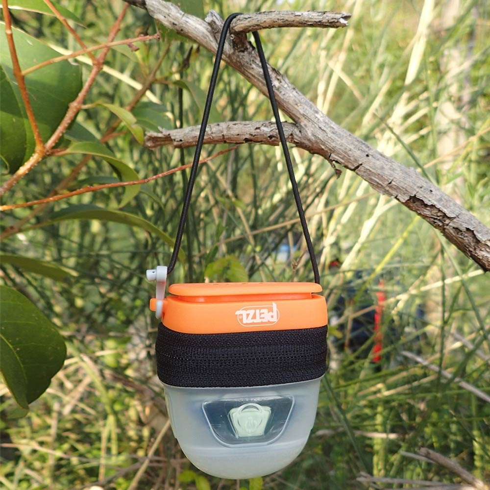 Petzl Noctilight Headlamp Diffuser Case - Hanging from tree branch outdoors
