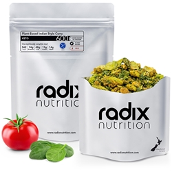 Radix Nutrition Plant-Based Indian Style Curry - KETO 600 - A vibrant curry combining green pieces of avocado and spinach, golden pieces of sliced almonds, and a bright variety of functional herbs and spices